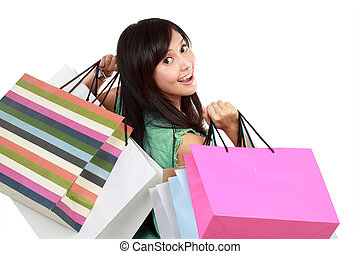 Potrait of Happy beautiful asian woman with a lot of shopping bags in isolated background