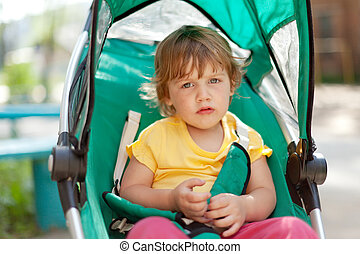 Potrait of two years child in stroller