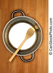 Pots And Pans - Pots and pans on a wooden kitchen bench