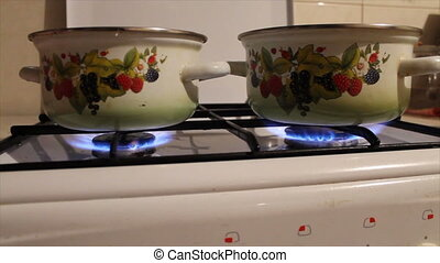 pots are on the fire on the gas stove