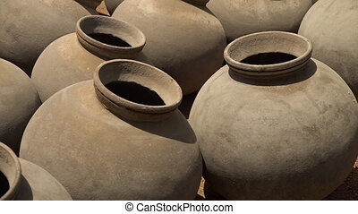Pots arranged side by side to each other - Extreme close up...