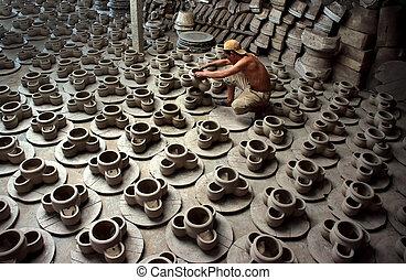 Potter arrange pottery product at factory ceramic