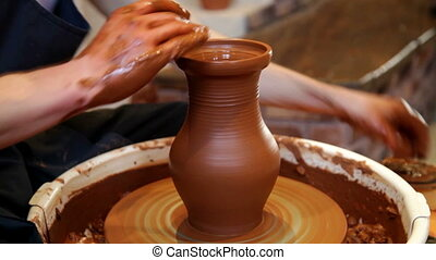 Potter at work - Hands of a Potter while working. Making...