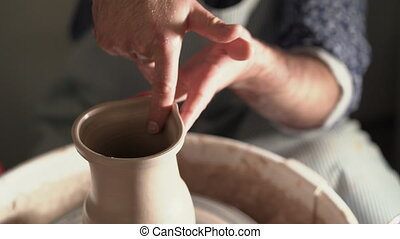 Potter creates jug nose, works on details and functionality...