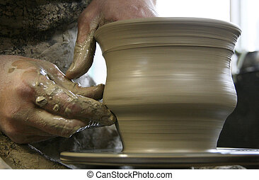 Potter - Hands of potter at work. Shallow depth of field.