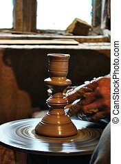 potter makes pottery, dark enamel, handmade, old craft