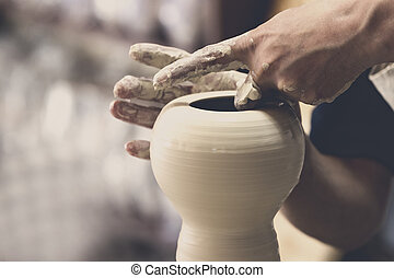 Potter makes pottery handmade in the workshop