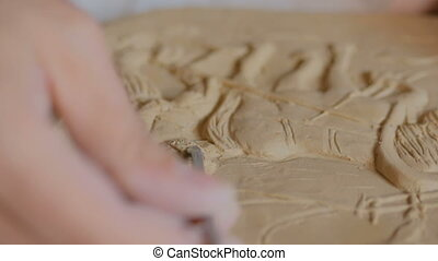 Potter making clay stamp picture - Professional male potter...