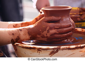 Potter making the pot in traditional style.