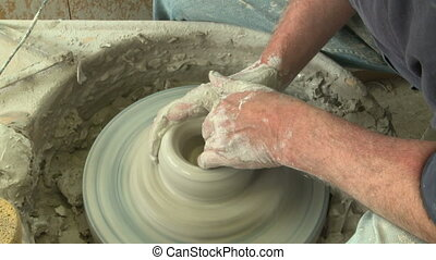 Potter shaping top of vase 7