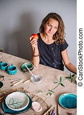 potter, tools, ceramics art concept - handsome young...