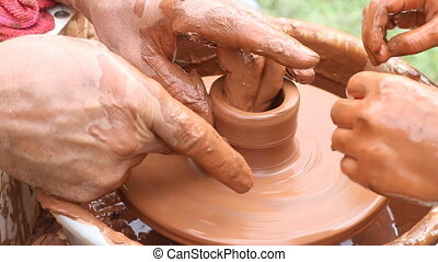 Potter Working On Pottery Wheel Making Clay Pot