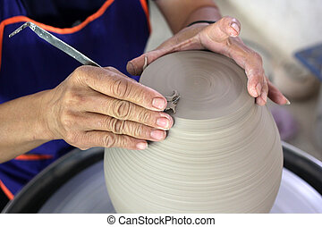 potter working on pottery wheel