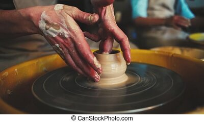potter's wheel in the pottery workshop. Handcraft Pottery...