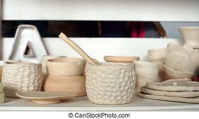 Pottery class workshop. Clay shaping on potter's wheel and firing.