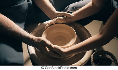 Pottery couple hands making clay jug, 4k. close up