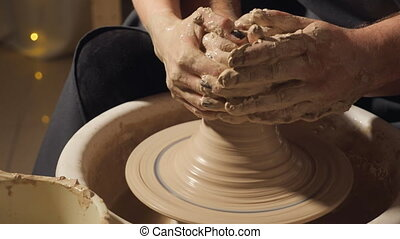 Pottery couple hands making clay jug, slow motion