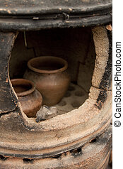 Pottery kiln - Old pottery kiln and pot. Pottery theme