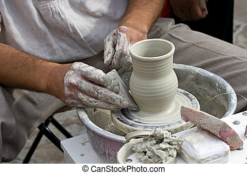 Pottery - Masters hands making a pot