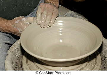 Pottery Spin - A potter throws his 20th bowl of the day