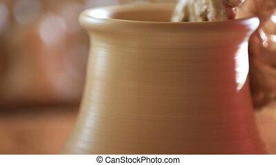 Pottery - Raising vase on pottery wheel