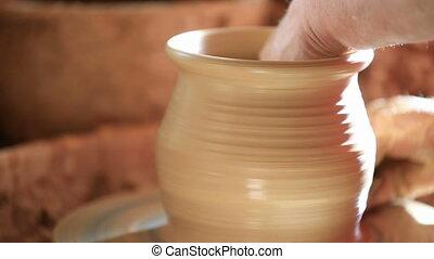 Pottery - Raising bowl on pottery wheel