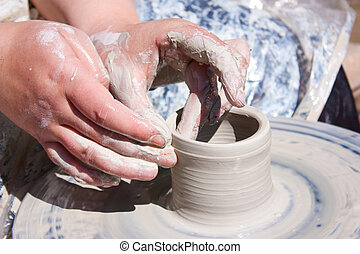Pottery Wheel - Potter hands working on pottery wheel