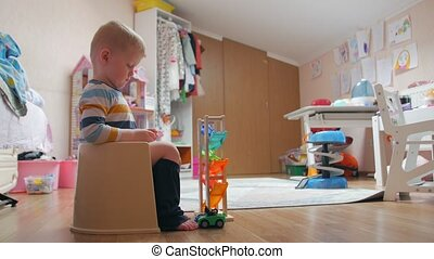 Potty boy with toys childrens room home interior