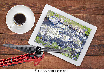 Poudre River and Canyon with high water and late spring scenery, reviewing an earial image on a digital tablet