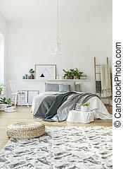 Pouf in modern bedroom interior