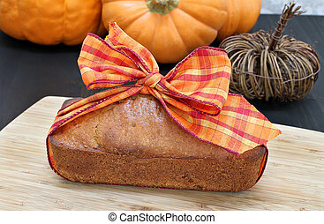 One generic pound cake wrapped in a fall ribbon - idea for a hostess gift.