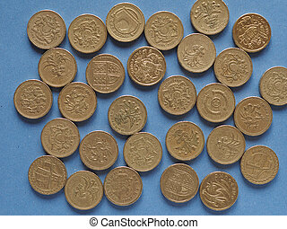 Pound coins, United Kingdom over blue