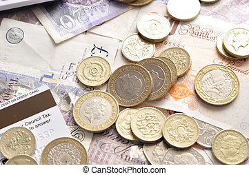 pound notes and coins - pound sterling bank notes and coins