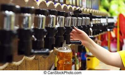 Pour beer in the store
