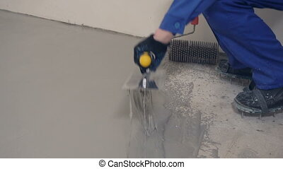 Pour half a plaster solution - Workers poured floor plaster...