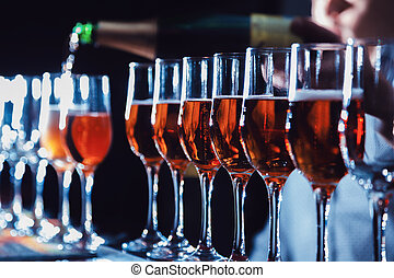 sparkling wine - pour sparkling wine into glasses. close-up