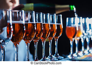 sparkling wine - pour sparkling wine into glasses. close-up