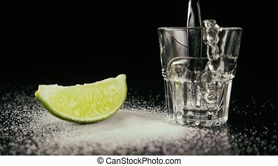 Pour tequila in a shot. Slow motion
