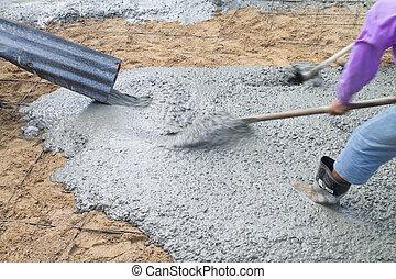 Pour the cement floor. - Concrete pouring during commercial...