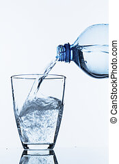 pour water into a glass