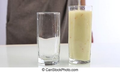 poured fruit smoothies in the glass for drinking healthy concept