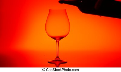 Poured into a glass of red wine, red