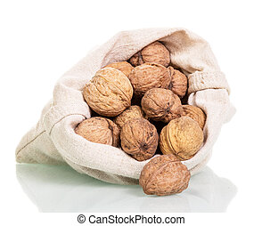 Poured out of the bag is not peeled walnuts isolated on white