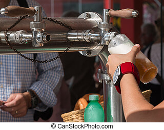 Pouring a Blonde Beer from the Tap, Pull a Pint