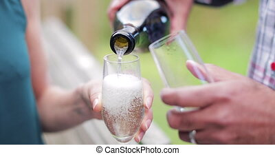 Pouring a Glass of Champagne - Close-up of champagne being...