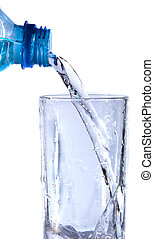 pouring a glass of water on white background