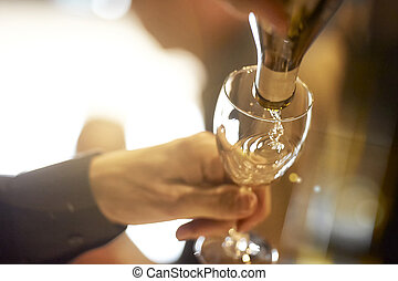 Pouring a glass of white wine