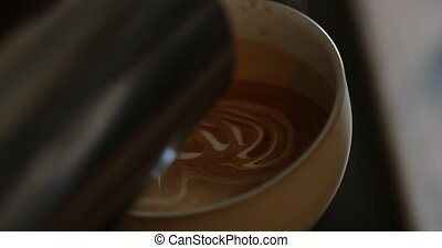 Pouring a Latte - Creating a Rosetta leaf, with milk, in a...