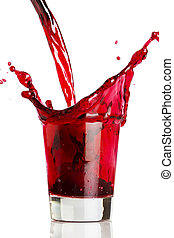 Pouring a red beverage - A red liquid being poured into, and...