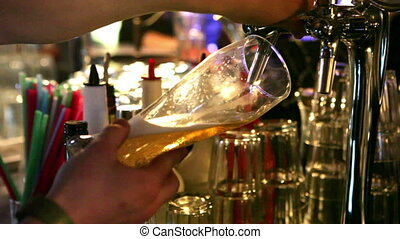 Pouring Beer  - Bartender pors beer into the glass at a club